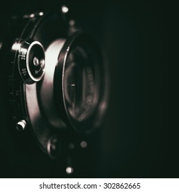 Retro view camera lens with vintage shutter, abstract techno backgrounds. Grungy texture