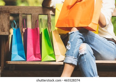 Retro vintage of asian woman with shopping bags in relax time, legs close up photography.