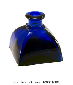 Retro vintage bottle made of blue glass isolated on white background.