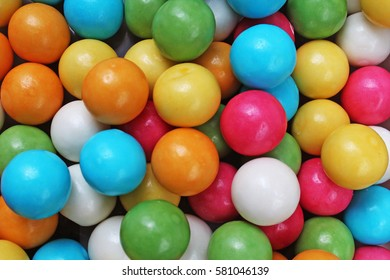 Retro vintage bubblegum balls. Bubble gum chewing gum texture. Rainbow multicolored gumballs chewing gums as background Round sugar coated candy dragee bubblegum texture. Colorful bubblegums wallpaper
