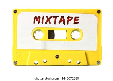 A retro vintage cassette tape (obsolete audio tech) with the handwritten text Mixtape (red marker, white label, electro yellow plastic body).