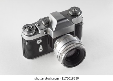 Retro vintage film camera on white background