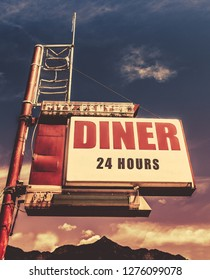 Retro Vintage Image Of Old Motel And Diner Sign In Small Town USA