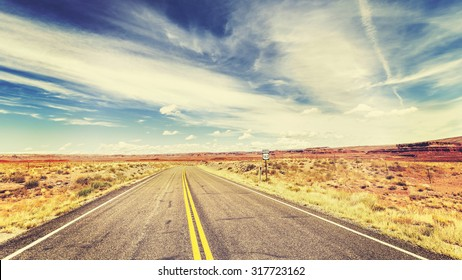Retro vintage old film style endless country highway in USA, travel adventure concept.