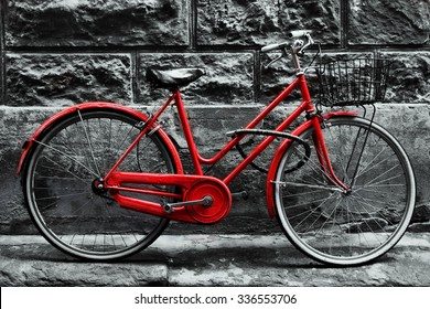 Retro vintage red bike on black and white wall. Old charming bicycle concept.