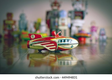 retro vintage rocket toy on wooden floor