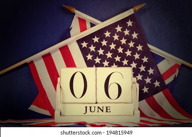 Retro vintage style D-Day calendar for anniversary of 6 June against a dark blue grunge background and USA stars and stripes and British UK Union Jack flags