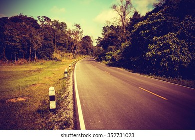 Retro or vintage style image of country asphalt road.