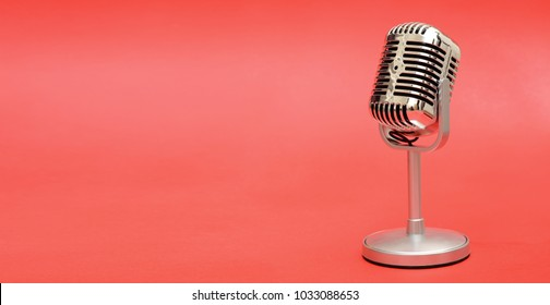 Retro vintage style metal microphone on red background banner