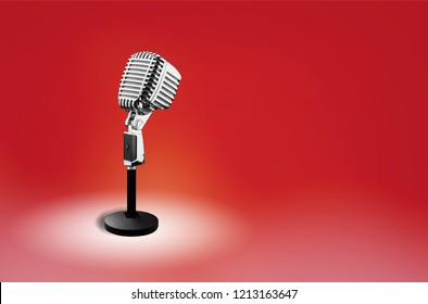 Retro vintage style metal microphone on red