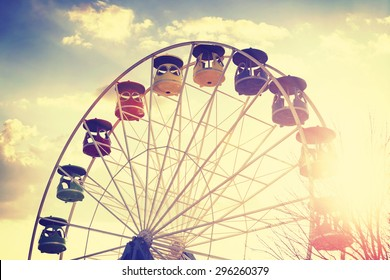 Retro vintage stylized picture of ferris wheel at sunset.