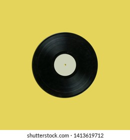 retro vinyl record with blank white label on yellow background