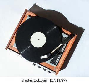 Retro vinyl turntable on white background. Photo with shadows, hard light, top view