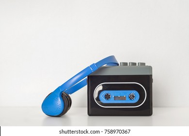 Retro walkman and headphones on the white shelf