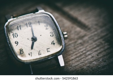 retro watch on a wooden background