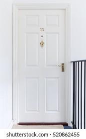 Retro white closed wooden entrance door 23