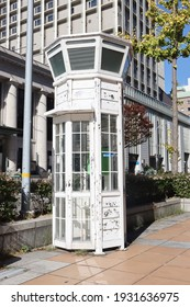 a retro white payphone booth