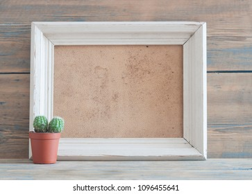retro white photo frame template vintage wood table and cactus