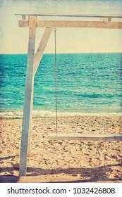 Retro white wooden swing at the shore of Black Sea in Romania