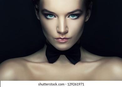 retro woman with black tie bow on neck