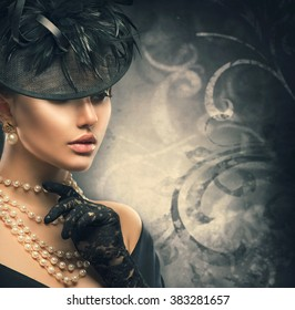 Retro Woman Portrait. Vintage Style Girl Wearing Old fashioned Hat, gloves, pearls necklace and earrings, retro Hairstyle and Make-up. Romantic lady over black background. Pearl Jewellery