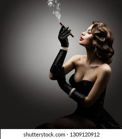 Retro Woman Smoking Cigar, Fashion Model Old Fashioned Beauty Portrait over Gray Background