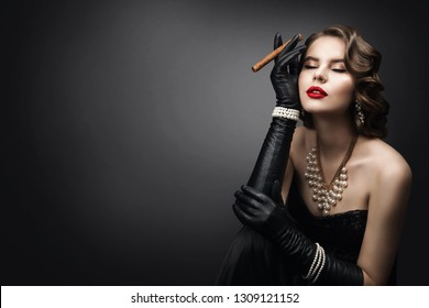 Retro Woman Smoking Cigar, Fashion Model Beauty Portrait, Old Fashioned Girl Dreaming over Gray Background