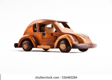 Retro wooden car model isolated on white