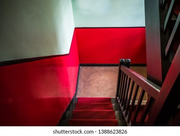 A retro wooden staircase painted in 1940s style decor.