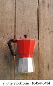 Retro zinc teapots on a wooden background.