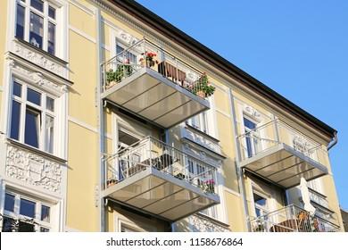 retrofit balconies on old apartment house
