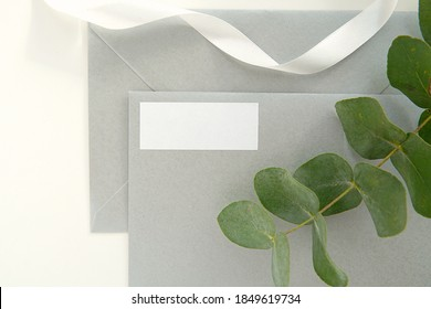 Return address label mockup on silver envelope, elegant wedding 1x2,5 empty sticker, eucalyptus branch.