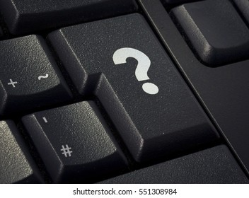 Return key of a black keyboard with the shape of a question mark imprinted .(series)