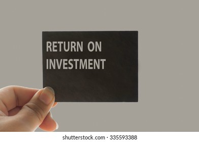 RETURN ON INVESTMENT message on the card shown by a man, vintage