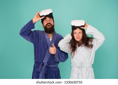 Return to reality. Man and woman explore vr. VR technology and future. VR communication. Exciting impressions. Awakening from virtual reality. Couple in bathrobes wear vr glasses. Conscious awakening.
