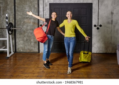 Returning home from travel, two women arrived at their loft apartment after vacation.