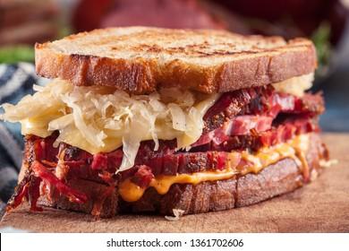 Reuben Sandwich with corned beef, cheese and sauerkraut. Classic New York dish
