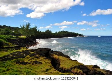 Reunion island landscape. Seascape. Black volcanic sand. Black rocks.
