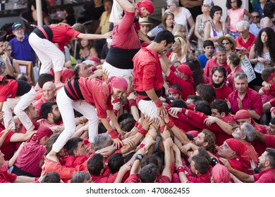 REUS, SPAIN - JUNE 25 - Those typical catalan human towers are performed in Mercadal Square. Diada castellera on June 25, 2016 in Reus, Spain.