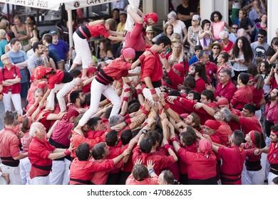 REUS, SPAIN - JUNE 25 - Those typical catalan human towers are performed in Mercadal Square. Diada castellera on June 25, 2016 in Reus, Spain.