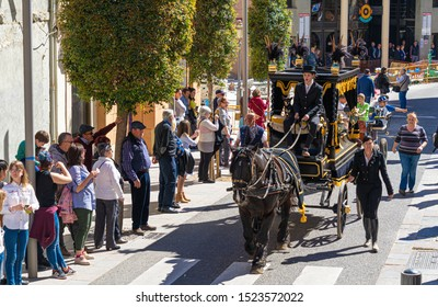 Reus, Spain. March 2018: vintage dressed people on top of a horse-drawn carriage. The Tres Tombs festival cavalcade. The Blessing of farm animals and even pets on the Day of Saint Anthony, patron