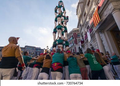 Reus, Spain. September 2017: Castells Performance, a castell is a human tower built traditionally in festivals within Catalonia. This is also on the UNESCO Intangible Cultural Heritage of Humanity