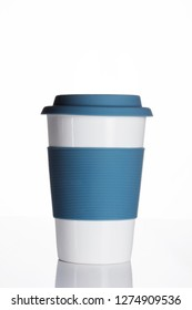 Reusable ceramic coffee mug with silicone sleeve and lid