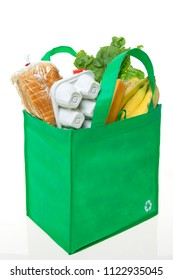 A reusable grocery bag with recycle symbol, filled with basic groceries.