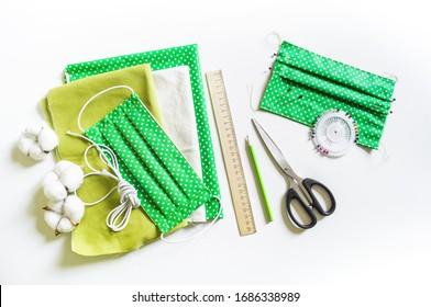 Wiederverwendbare medizinische Maske. Null Abfall. Coronavirus-Epidemie. Schutz vor einem Virus. Weißer Hintergrund. Material für Kreativitätsgewebe
