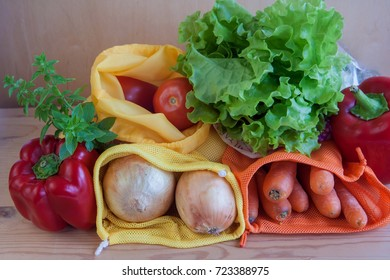 Reusable mesh produce bags with vegetables