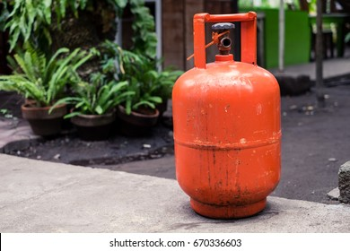 Reusable orange tank of Liquefied Petroleum Gas or Liquid Petroleum Gas (LPG). Portable, cost effective and efficient especially way to heat off-grid homes. Selective focus.  Copy space in the left.