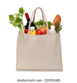 Reusable shopping bag full of groceries isolated on white background / clipping path