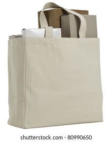 Reusable shopping bag with various plain cardboard boxes.