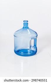 Reusable standard five-gallon plastic water bottle for cooler white background